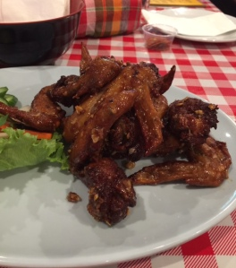 Ike's Vietnamese fish sauce chicken wings are a signature dish at Pok Pok. Named after chef Ricker's friend, Ich Truong, the wings can be ordered spicy. (photo by Jill Weinlein)